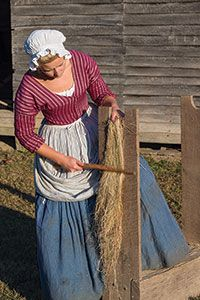 A scutching board and knife are used to smooth the flax.
