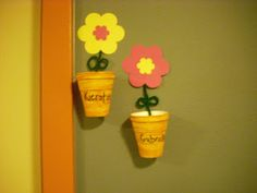 Flower pots! Colored Styrofoam cups and a paper flower!