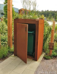 Corten kliko container ombouw by ABK Outdoor Don't want to look at your bin? (Wouldn't be tough to build) Landscape Walls, Landscape Design, Dream Garden, Home And Garden, Garbage Shed, Steel Sheds, Garden Solutions, Bike Shed, Corten Steel