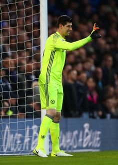 Thibaut Courtois of Chelsea signals during the Premier League match between Chelsea and Southampton at Stamford Bridge on April 25, 2017 in London, England.