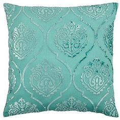 tiffany blue pillows all over my bedroom and on the bed make for a cozy and inviting look