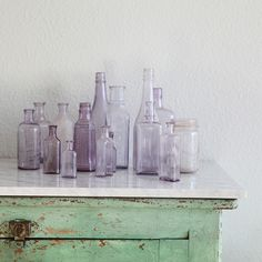 Love collecting glass! I also love green weathered furniture-reminds me of the beach!