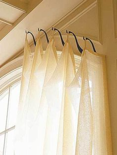 genius idea for odd shaped/sized windows; hooks instead of a rod