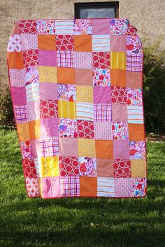 I love these colours!  They are indeed happy!  Very pretty.  The simplest quilts are the best!  From Noodlehead.