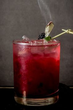 SMOKING BLACKBERRY SAGE MARGARITA - 11 Classy Halloween Treats (and Drinks) for Grown-Ups via @PureWow