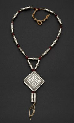 Africa | Necklace from the Tuareg people of Niger | Silver and red glass beads | ca. 1970.