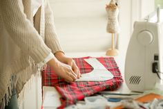 Woman working with a sewing design pattern. Concept photo
