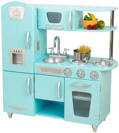Young chefs will love cooking up feasts for the whole family with the adorable Kidkraft Blue Vintage Kitchen. The Kidkraft Blue Vintage Kitchen is made of wood, doors open and close, oven knobs click and turn and the sink is removable for easy cleanup