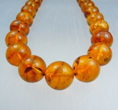 Amber necklace/round 14mm.