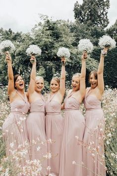 must take wedding photos with bridesmaids rosy colors hands up with bouquets rebecca carpenter photography