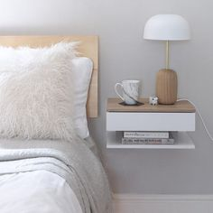 Floating Bedside Table Our signature product, the Urbansize floating bedside table attaches to the wall to maximise space use in small bedrooms. A floating bedside table is the perfect answer when you