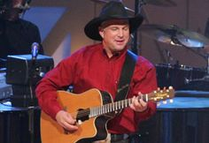 Garth Brooks   totally wish I could have gone to one of his concerts back then.