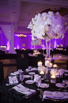 Hydrangeas, white roses, and white orchids centerpiece - hate the purple love the centerpiece