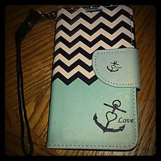 LG tribute cell phone/wallet case Turquoise and striped cellphone case with built in wallet! Magnetic front flap and a small handle that can be taken off. Accessories Phone Cases https://womenslittletips.blogspot.com http://amzn.to/2lkg9Ua