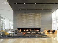 Richard Meier & Partners Architects suspended Ingo Maurer's custom chandelier above George Nakashima's chairs in the lobby of the Hotel Seamarq in Gangneung, Sou...