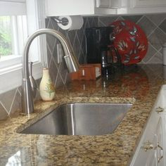 Kitchen Remodel with Granite Countertops and Tile Backsplash by Hatchett Design/Remodel