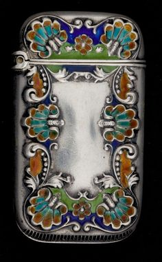 AN AMERICAN SILVER AND ENAMEL MATCH SAFE