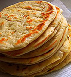 One of the most well-known foods in Greek cuisine is pita bread. It's used to scoop-up dips that are usually included in the mix of mezedes (Greek appetizers).