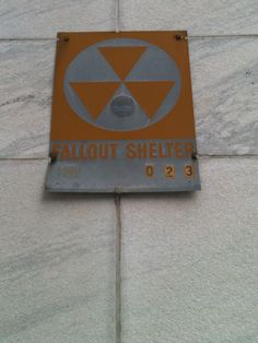 What's the deal with the metal fallout shelter signs downtown ...