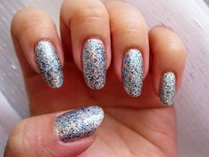 Sally Hansen Gem Crush in Showgirl Chic - a silver glitter with sparse blue hexagonal glitter. Click the image for more!