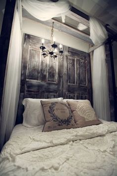 old doors/pallet wood used as headboards and canapy