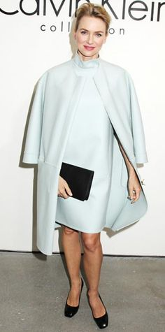 Look of the Day › February 14, 2014 WHAT SHE WORE Watts draped a minimalist sky-blue coat over her matching high-collar Calvin Klein Collection dress, grounding the pale color with a gold cuff and dark accessories.