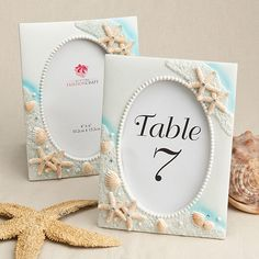 Bring the beach to your special day with our Beach Theme Table Number Holder and Picture Frame! Your guests will love the idea of incorporating your beach theme into your wedding by displaying these beautifully decorated frames as your table number holders at your reception. Each hand painted frame is made of a poly resin material and measures 5 1/2� x 7 1/4�. Frame will hold a 4x6 photo.Minimum Order of 3 Pieces