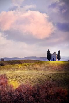 The Chapel Madonna di Vitaleta is a small sacred building that sits on top of a hill on the road that connects San Quirico d'Orcia, Pienza Italy.  by Marco Carmassi on 500px