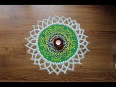 Here is a simple freehand diwali special flower rangoli design for Diwali. It is based on one of my original rangoli designs and I have tried to do some inno. Rangoli Colours, Colorful Rangoli Designs, Rangoli Designs Diwali, Kolam Rangoli, Flower Rangoli, Beautiful Rangoli Designs, Kolam Designs, Special Rangoli, Special Flowers