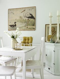 white dining room with vintage decor