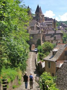 Conques, Midi Pyrenees, France. 30km east of Figeac, 35km north of Rodez. Listed as one of the most beautiful villages of France. Built on a hillside, it has classic narrow Medieval streets, so that large vehicles are prohibited and most visitors enter on foot.  More travel info here: francethisway.com...
