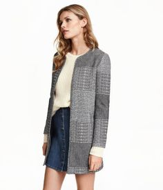 $49.99 Short, straight-cut jacket in textured-weave fabric with front pockets and no buttons. Lined.