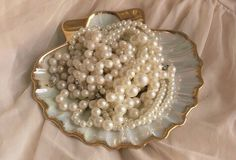 Porcelain scallop seashell with gold edges, pearls