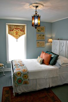 colorful quilt on white bedding with sweet valance