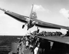 Sailors duck for cover as a TBF Avenger of Torpedo Squadron (VT) 31 drifts over the port catwalk of the carrier Cabot (CVL 28) during an attempted recovery on December 14, 1943, sixty-nine years ago today.
