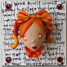 Arizona's Jill Penney is a pop surrealist doll artist who makes polymer clay dolls that are part punk, part comic book, part anime, slightly deviant…what's being called low-brow art. The style has roots in tatoos and graffiti and is wildly popular on the west coast. ♥♥