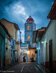 Cobble stone streets with church at Sancti Spiritus, Cuba, By EsrAli