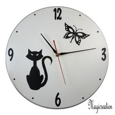 commande horloge chat assis et papillon - Boutique www.magicreation.fr Clock, Boutique, Wall, Home Decor, Clocks, Cat Clock, Wall Clocks, Butterflies, Watch