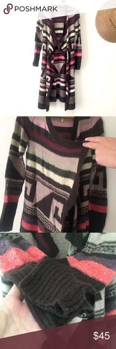 Free People knit sweater Duster length Free People sweater falls slightly below the knee. Open front with extra material to wrap yourself in or let hang. Great pattern with contrast of neutral tones and a little pop of color. The material is soft and has some stretch. One minor flaw shown in the fourth photo, a hole smaller than the size of a pea - likely from hanging in my closet untouched for so long - easily fixable with some thread. Free People Sweaters