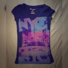 Aeropostale Navy Blue Graphic V-Neck An Aeropostale v-neck with NYC graphics on it. Very cute and tight but nice for a medium. Fits well for a small. Willing to take offers. Thank you! ❤️ Aeropostale Tops Tees - Short Sleeve