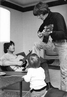 George Harrison with John Lennon and Julian