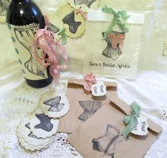 lingerie shower package with cake toppers, wine bottle wrappers and invites
