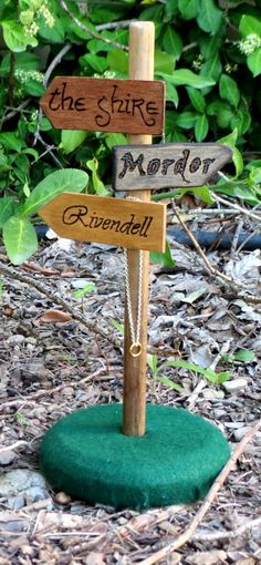 This will keep me headed in the right direction! Desk top road sign post Lord of the Rings Hobbit by OohhhBurn, $35.00