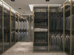 Brushed aluminum doors with safe clear glass for a minimalist wardrobe ... bespoke wardrobes, our passion !!!