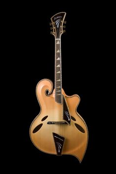 John Monteleone archtop: his own interpretation of the Teardrop guitar invented by the master John D'Angelico and re-interpreted by Jimmy D'Aquisto... All three are priceless.
