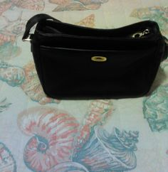 Liz Clayborn purse This is a Liz Clayborn Villager addition. It's black leather, and perfect for anything. Liz Clayborn Bags Shoulder Bags