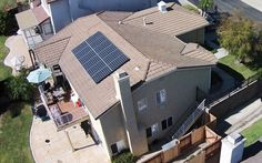 Cool aerial photo of a solar panel installation on a roof.