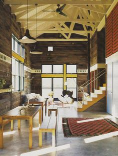 love the concrete floors.  bright ceiling, barn wood walls