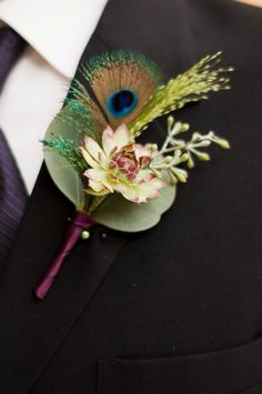 Groomsmen each wore a boutonniere of living succulents, seeds from Seeded Eucalyptus, Fountain grass & peacock feathers. Their stems were treated in the same manor as the Groom's.