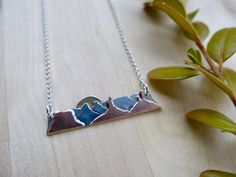 Frontera Designs creates custom mountainscape and desertscape jewelry so that you can carry your favorite place with you whereever you wander. Jewelry Shop, Nice Jewelry, Jewelry Making, Mixed Metal Jewelry, Mixed Metals, How To Make Beads, Graduation Gifts, Arrow Necklace, Pendants